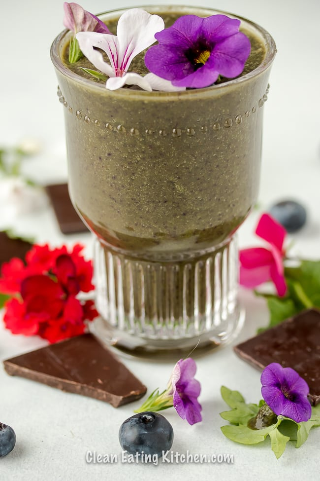 vegan chocolate blueberry smoothie with purple and red flowers