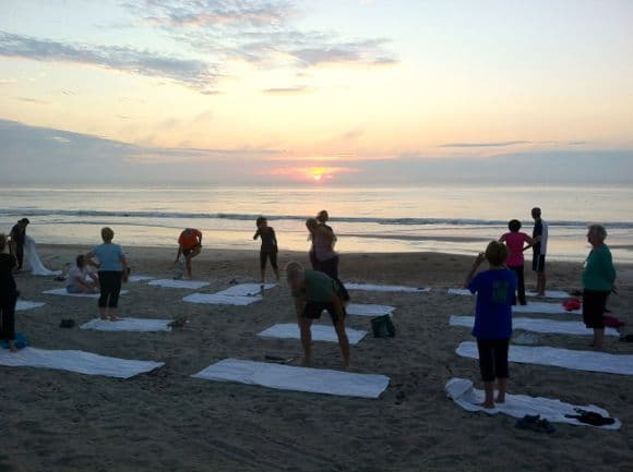 More yoga on the beach, dolphins in the surf.