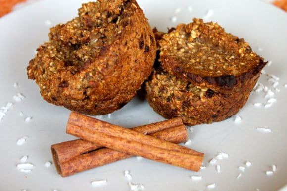 Cinnamon Oat Muffins on a plate with cinnamon sticks