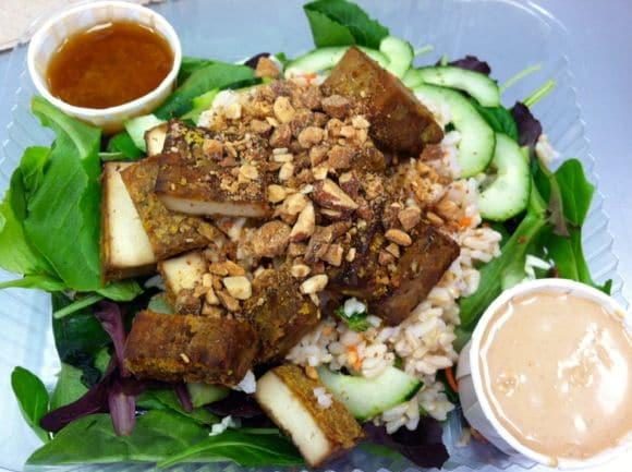 Roasted tofu salad with peanut sauce.