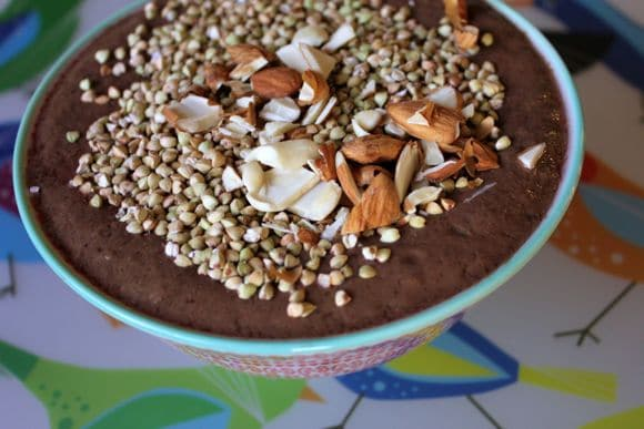 Leftover green smoothie with buckwheat groats and almonds.