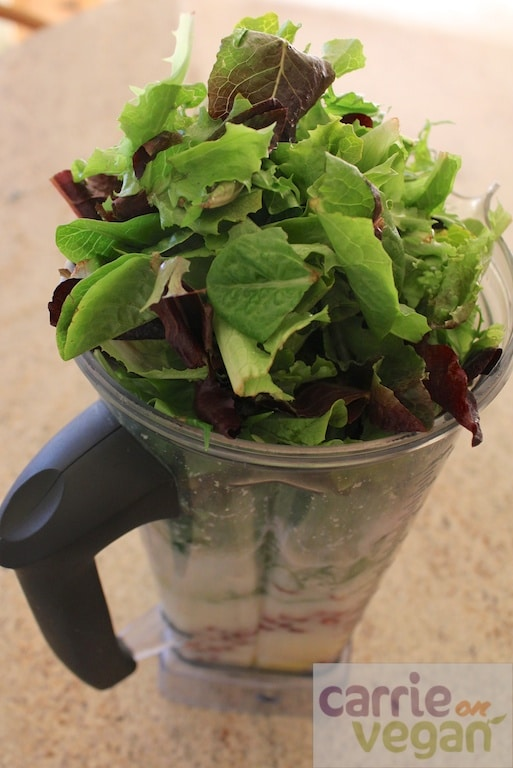 Vitamix overflowing with greens.
