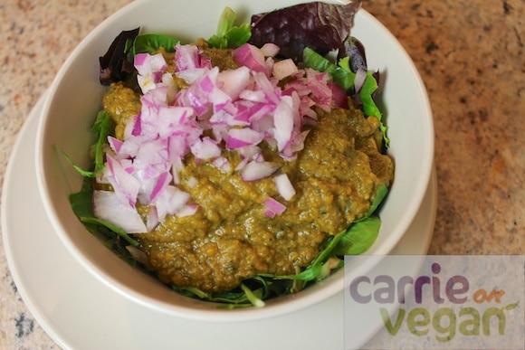 Soup served over fresh salad greens.