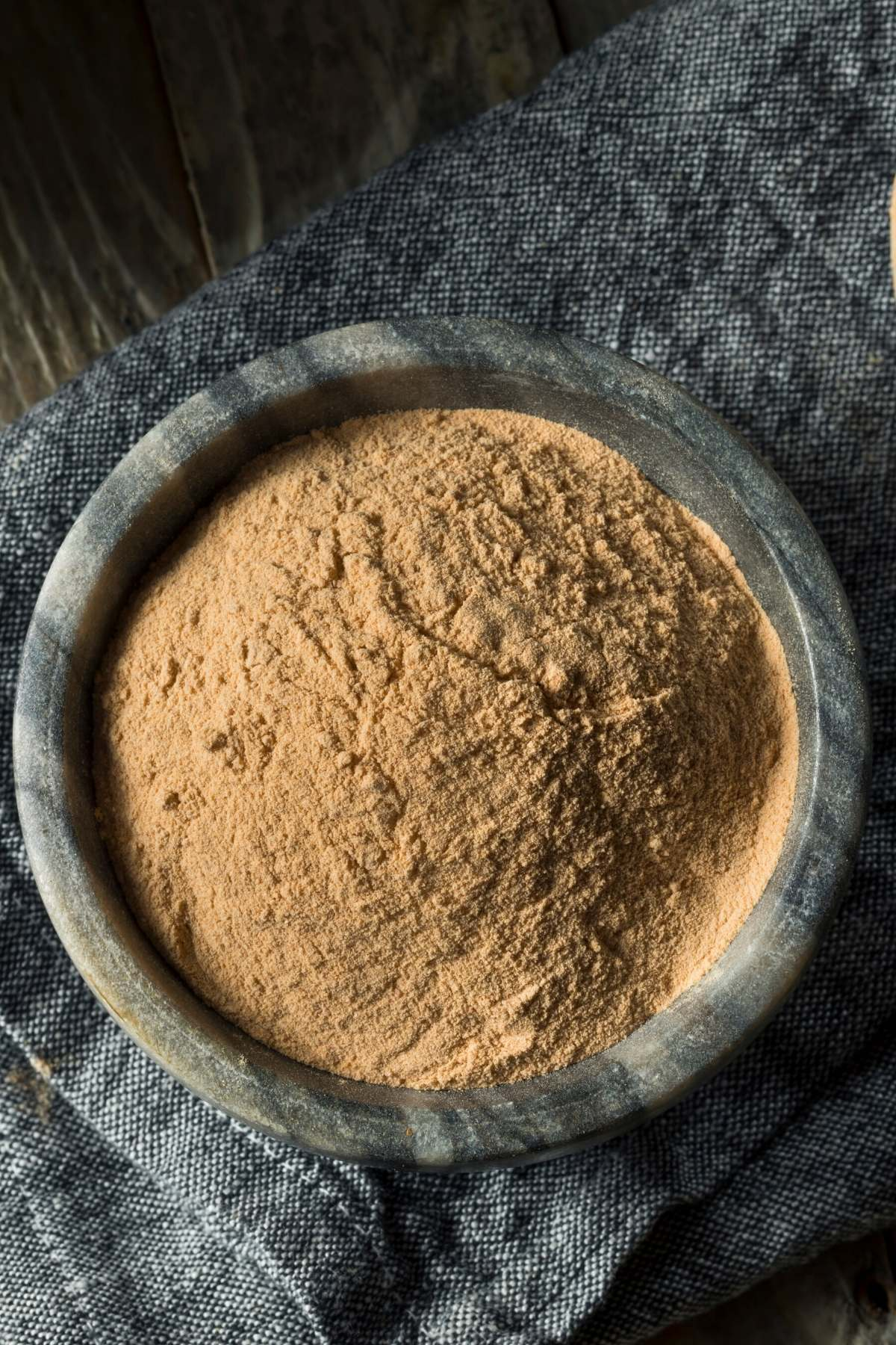 brown lentil powder in a bowl