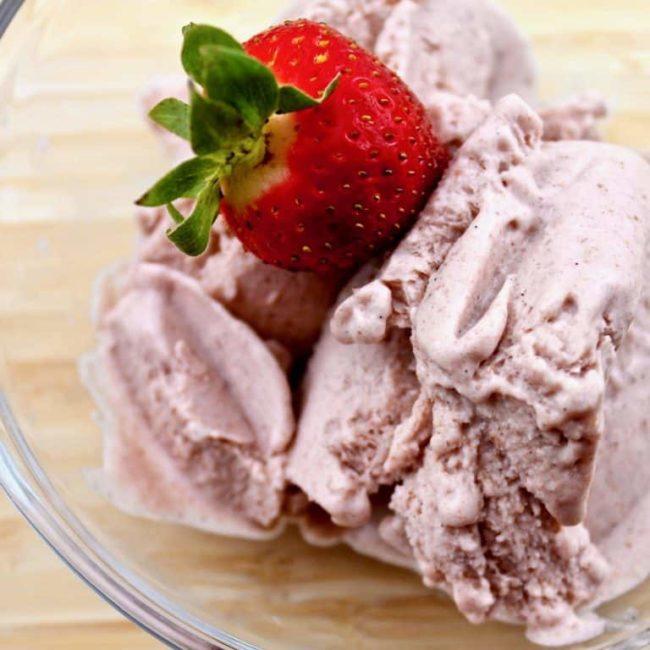 Strawberry Vanilla Nice Cream with a strawberry on top