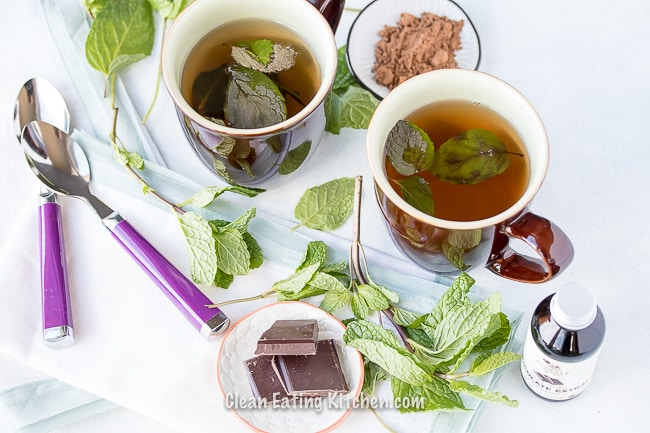 vegan chocolate mint tea with chocolate pieces and cocoa powder and fresh mint leaves