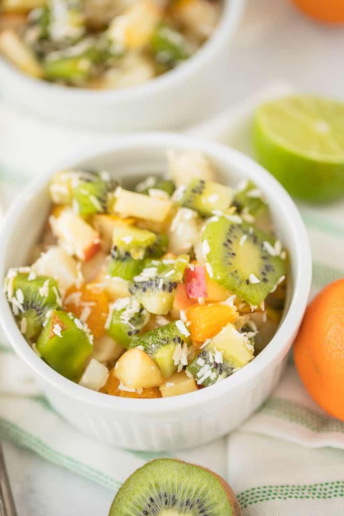 bowl of fruit salad with kiwi and oranges