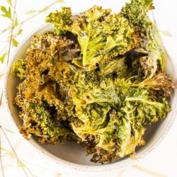 baked kale chips in white bowl
