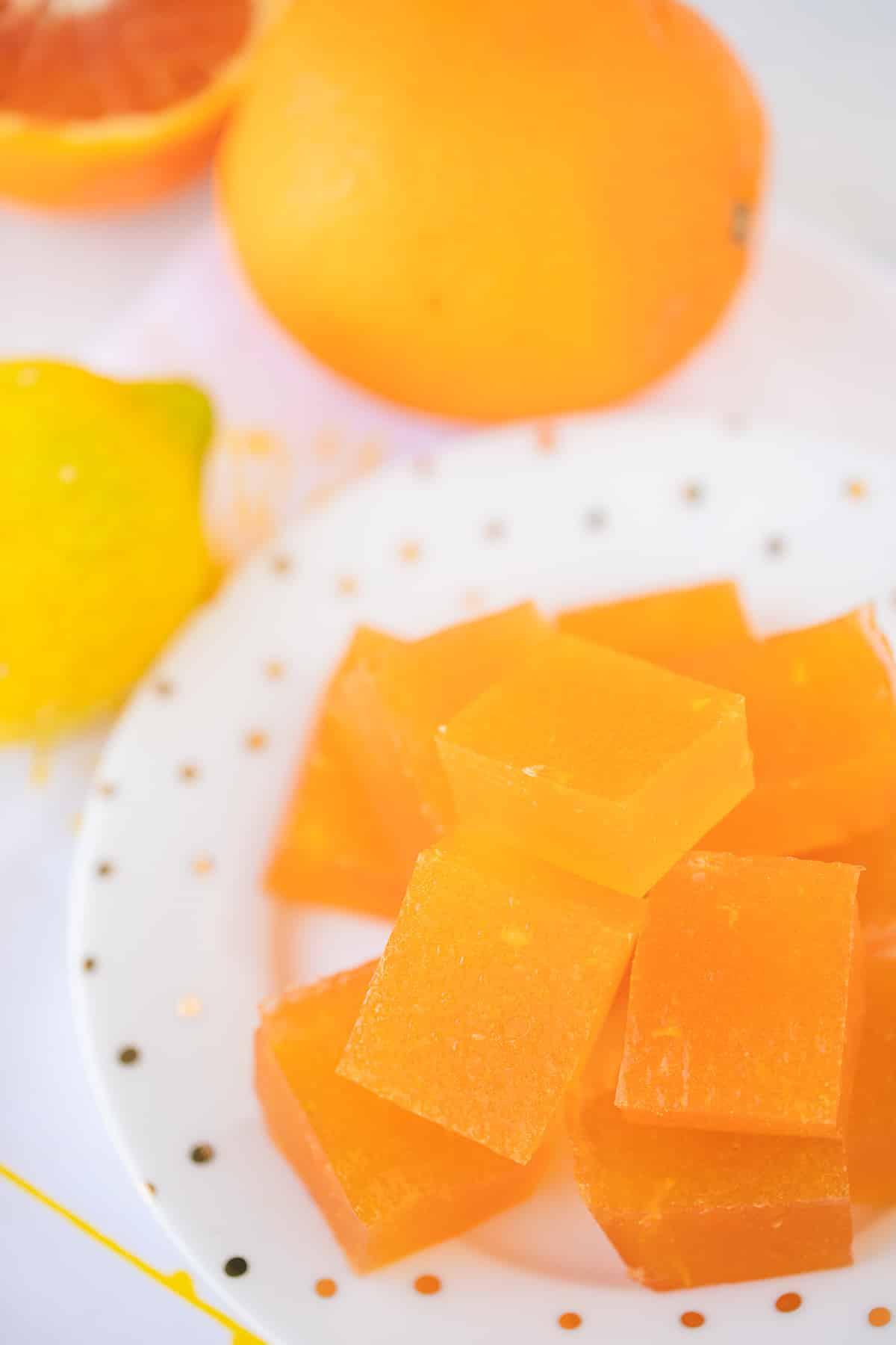 orange jello squares on a plate