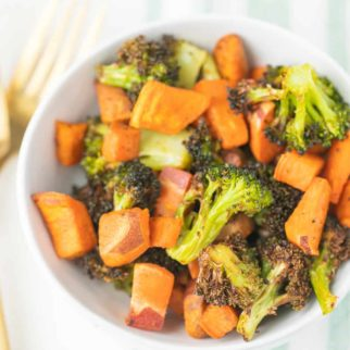 bowl of roasted vegetables with a gold fork