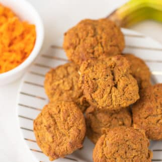 plate of muffins with a bunch of bananas and shredded carrots