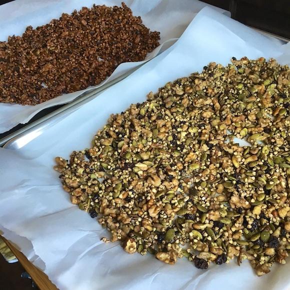 Chocolate Buckwheat Granola on baking sheets