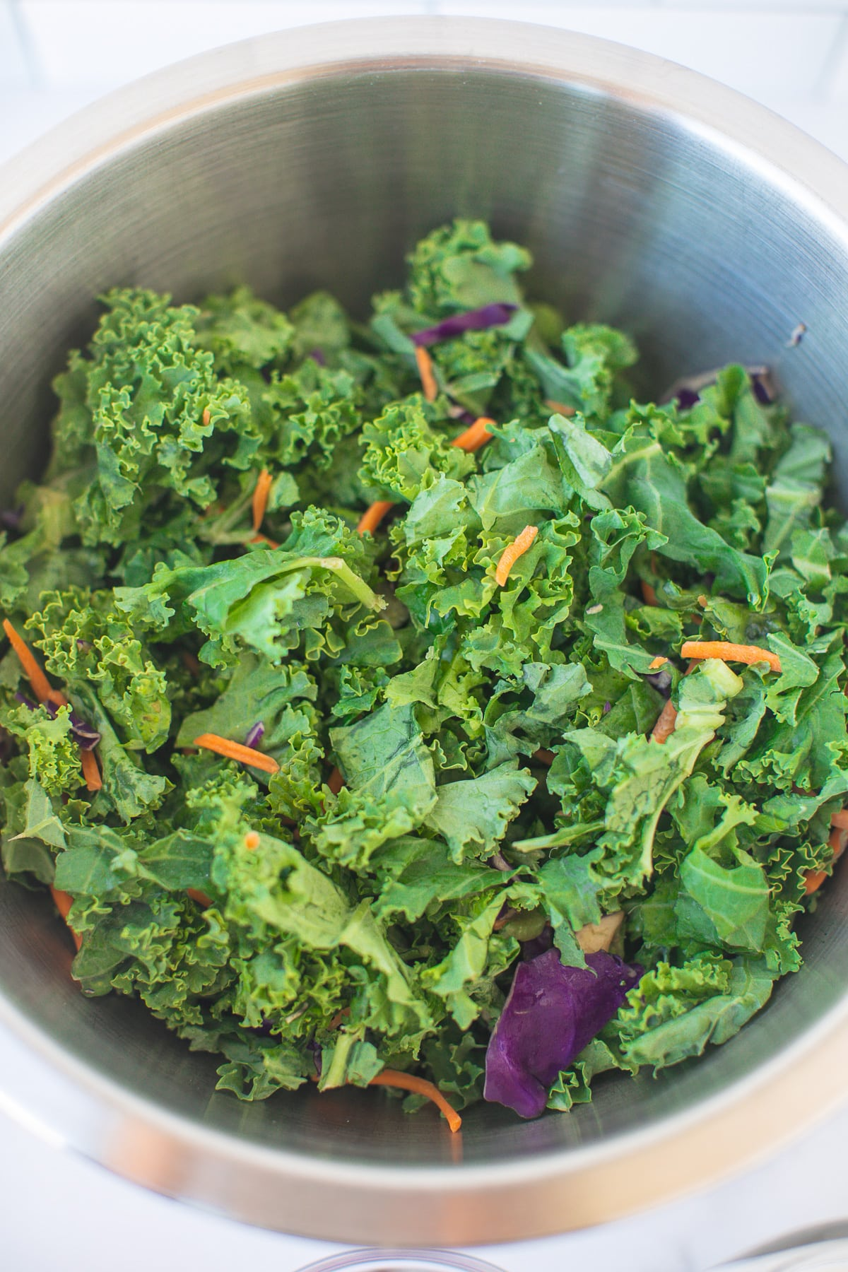 bowl of shredded kale salad with no dressing