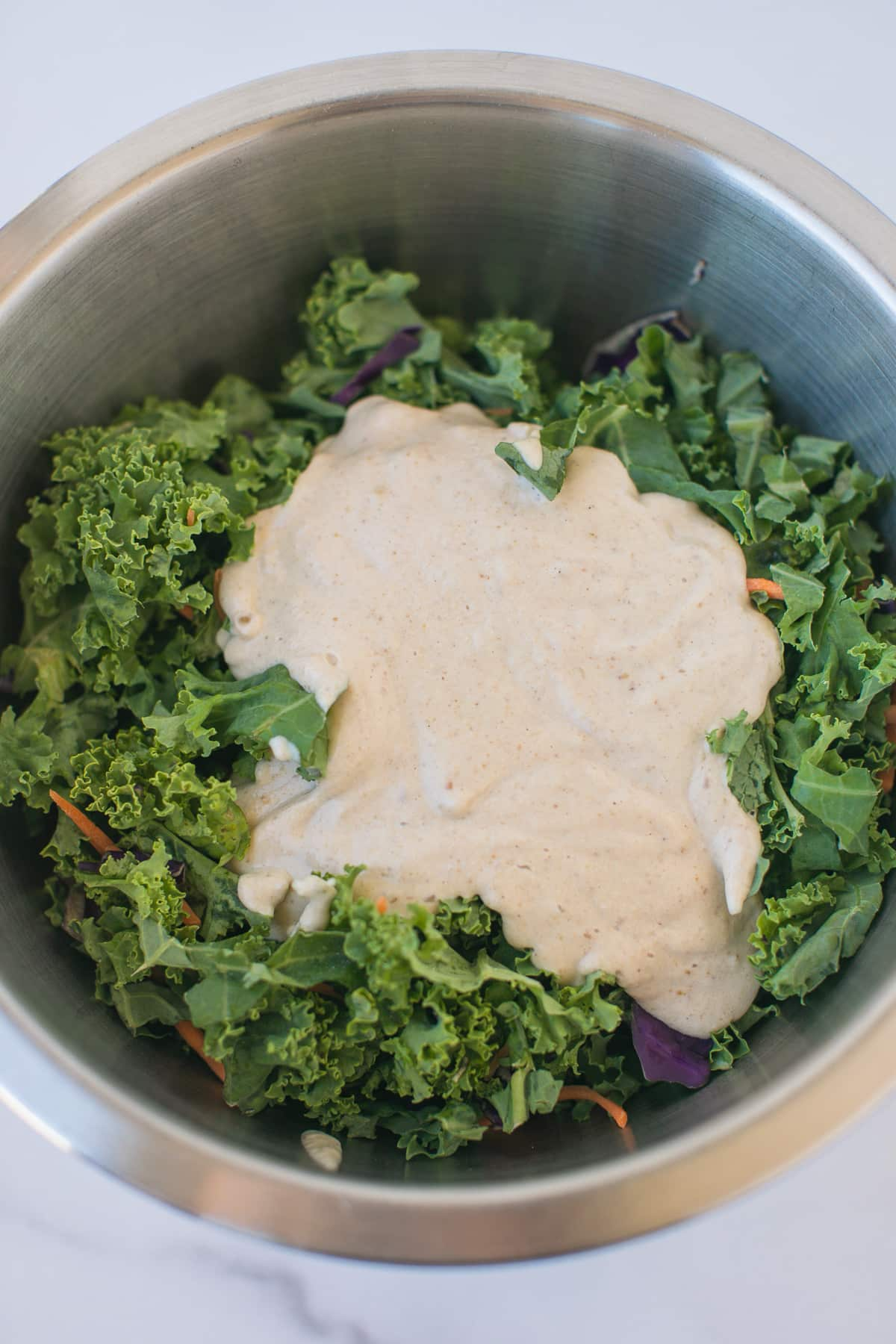 kale salad with dressing on top
