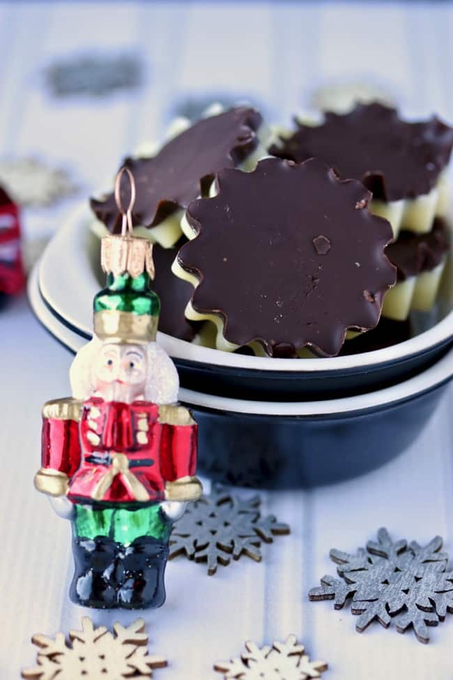 homemade peppermint patties in bowl with nutcracker ornament