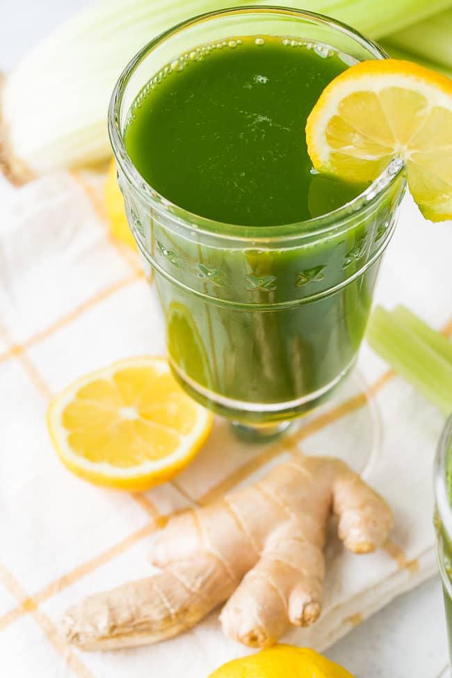 lemon ginger green juice with fresh lemon wedge
