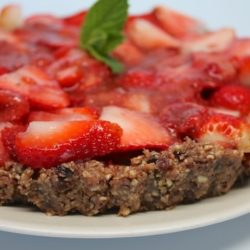 A close up of strawberry tart on a plate