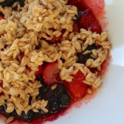 Bowl of sprouted oat groat cereal with berries