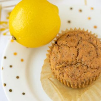 lemon muffin served on a plate with a gold fork