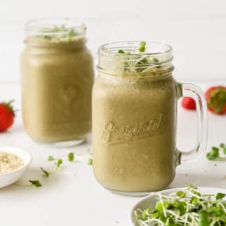 two glasses of broccoli sprout smoothie