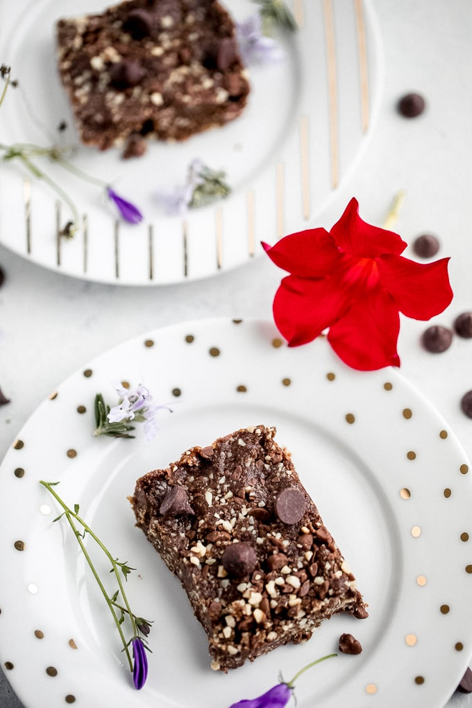two plates of brownies with flowers