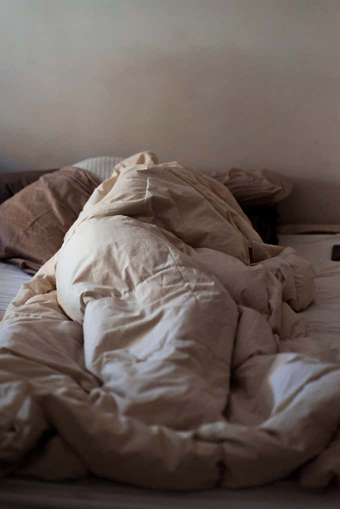 woman in bed with depression
