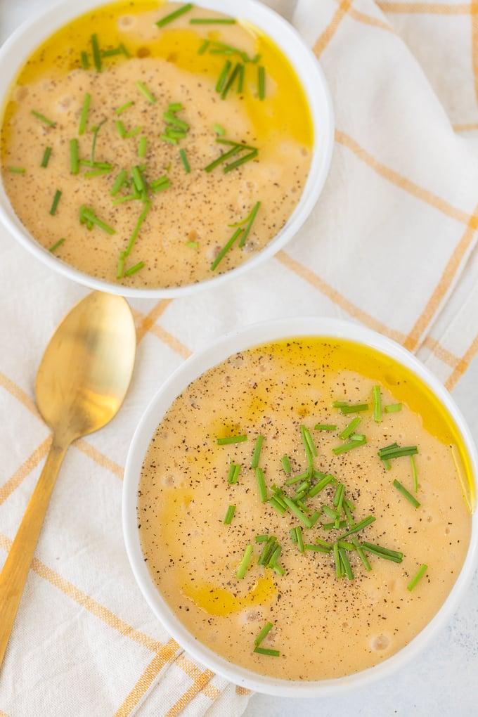 two bowls of vegan potato leek soup