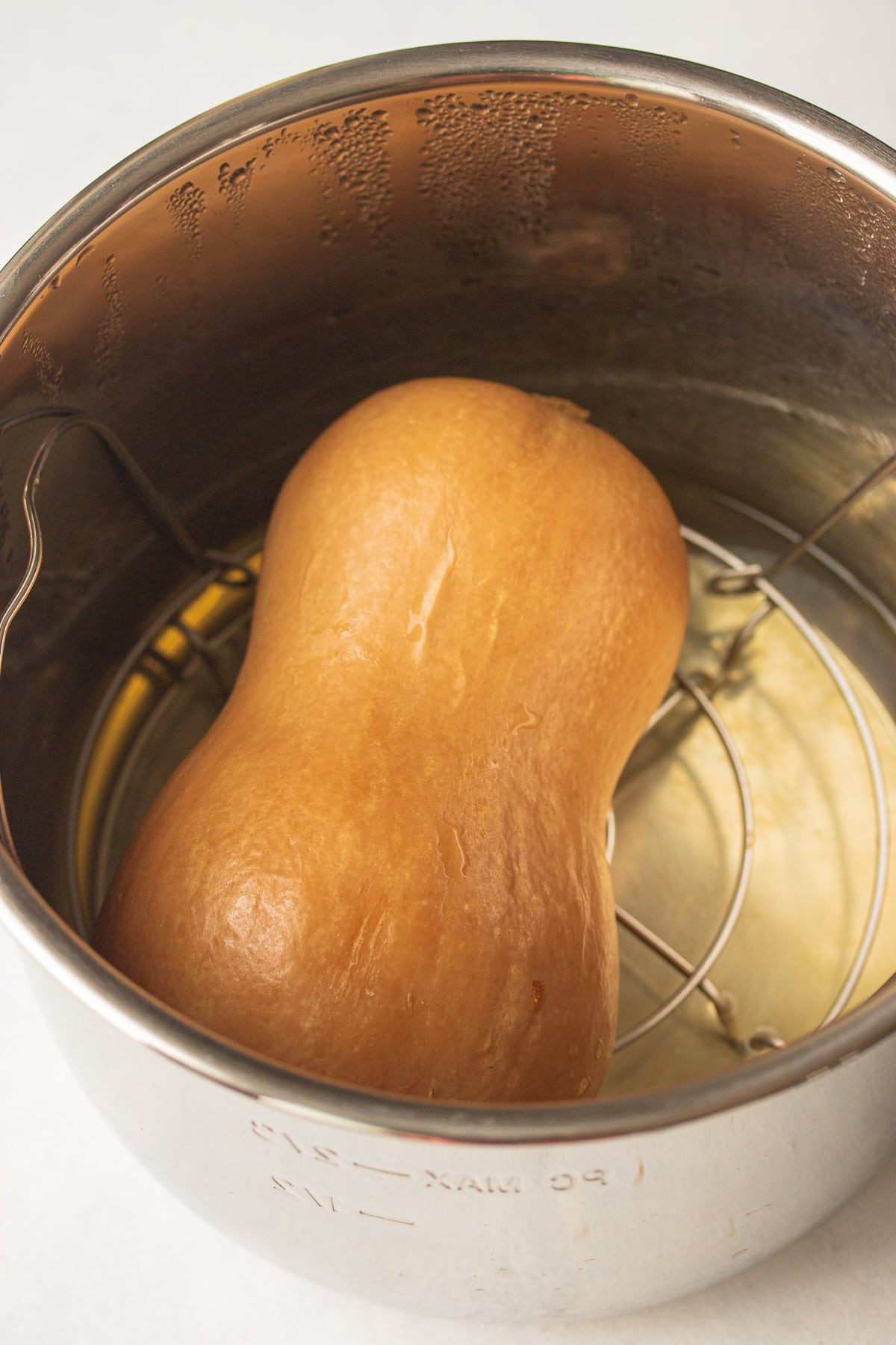 butternut squash cooked whole inside of an instant pot pressure cooker