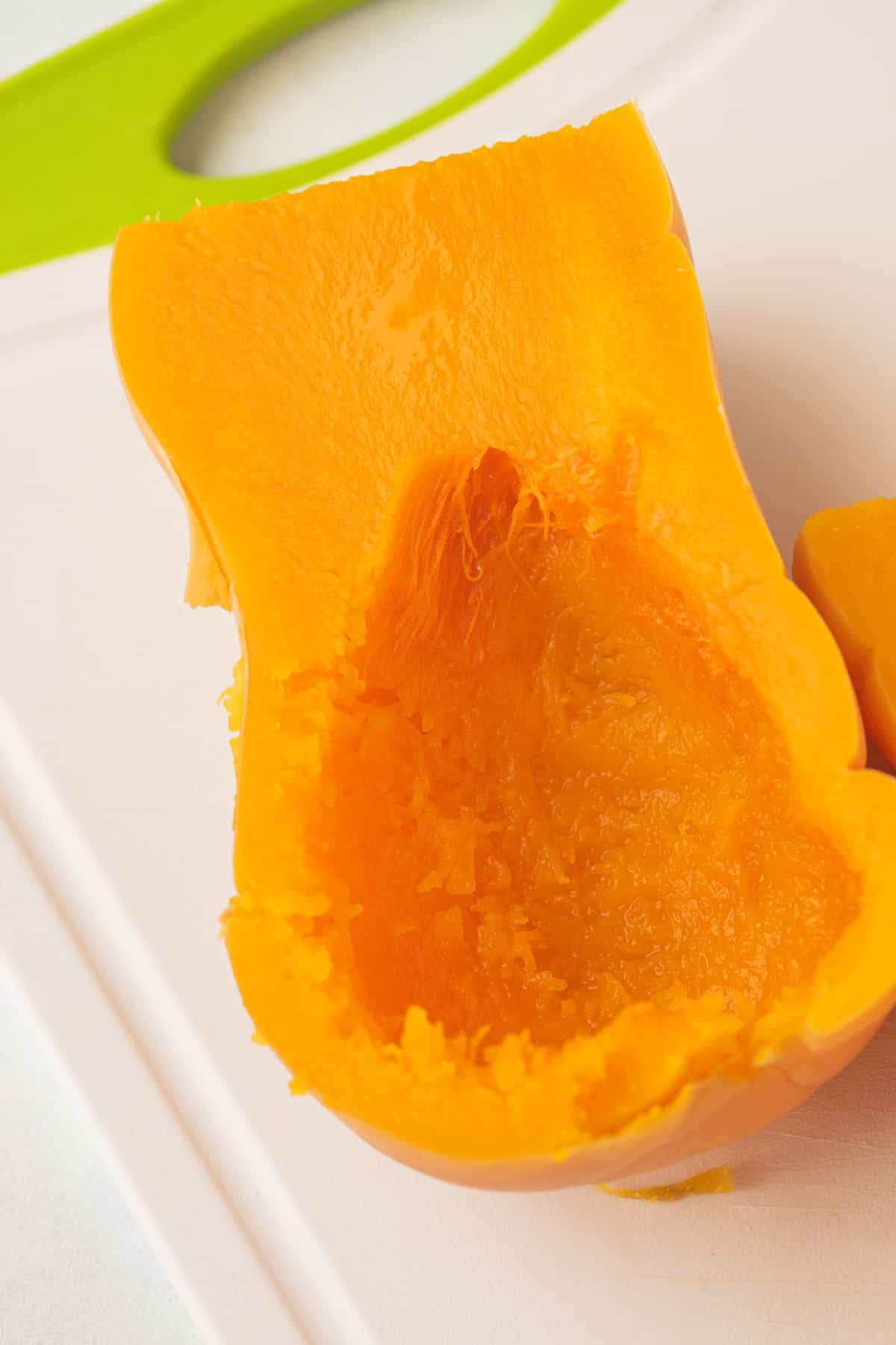 cooked butternut squash with the seeds removed