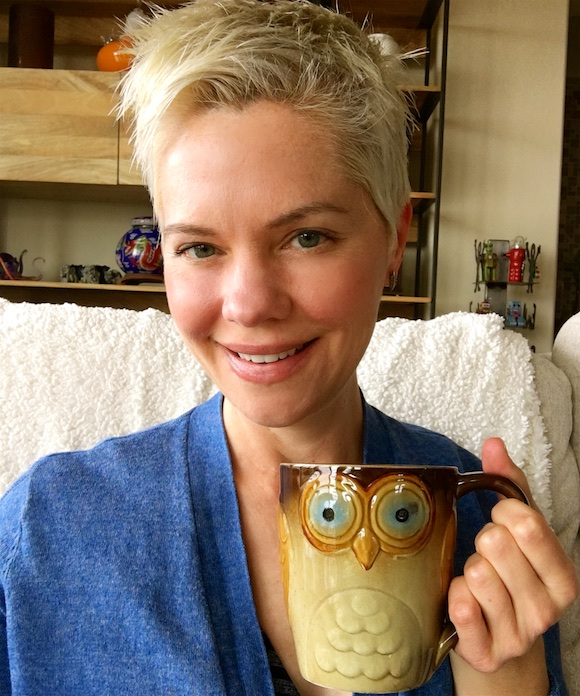 Carrie with owl mug smiling