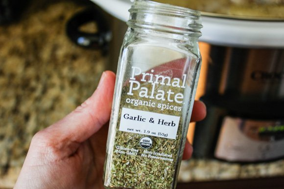 Primal palate garlic & herb spice jar up close in hand