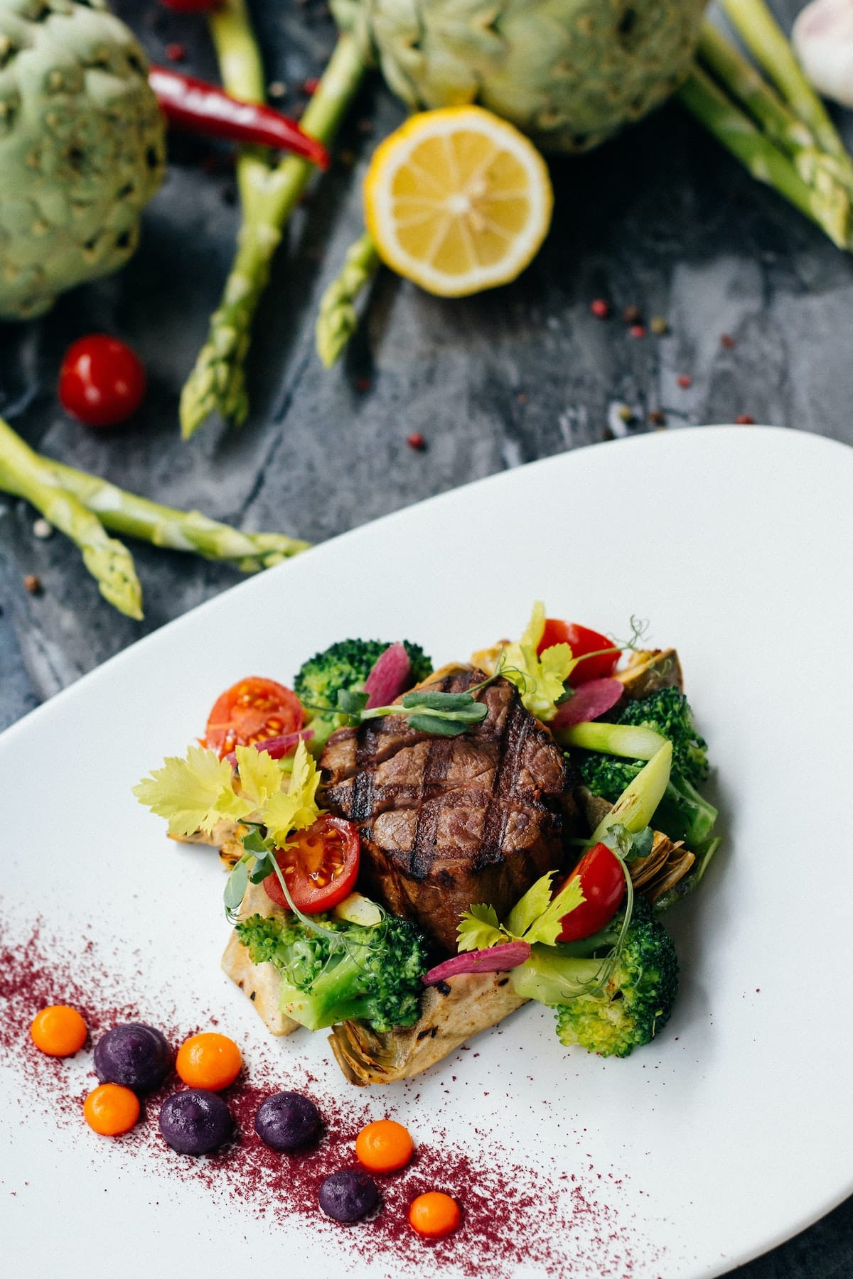 cooked steak with vegetables on a plate
