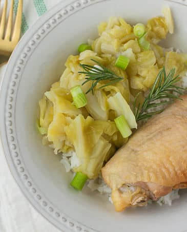 crockpot chicken thighs and cabbage in bowl with gold fork