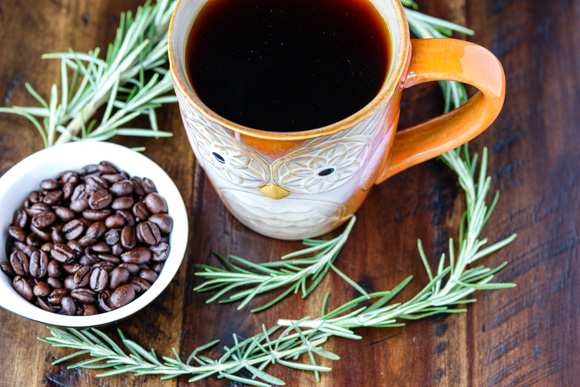 rosemary with coffee beans and mug