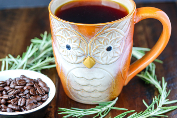 osemary with coffee beans and orange mug