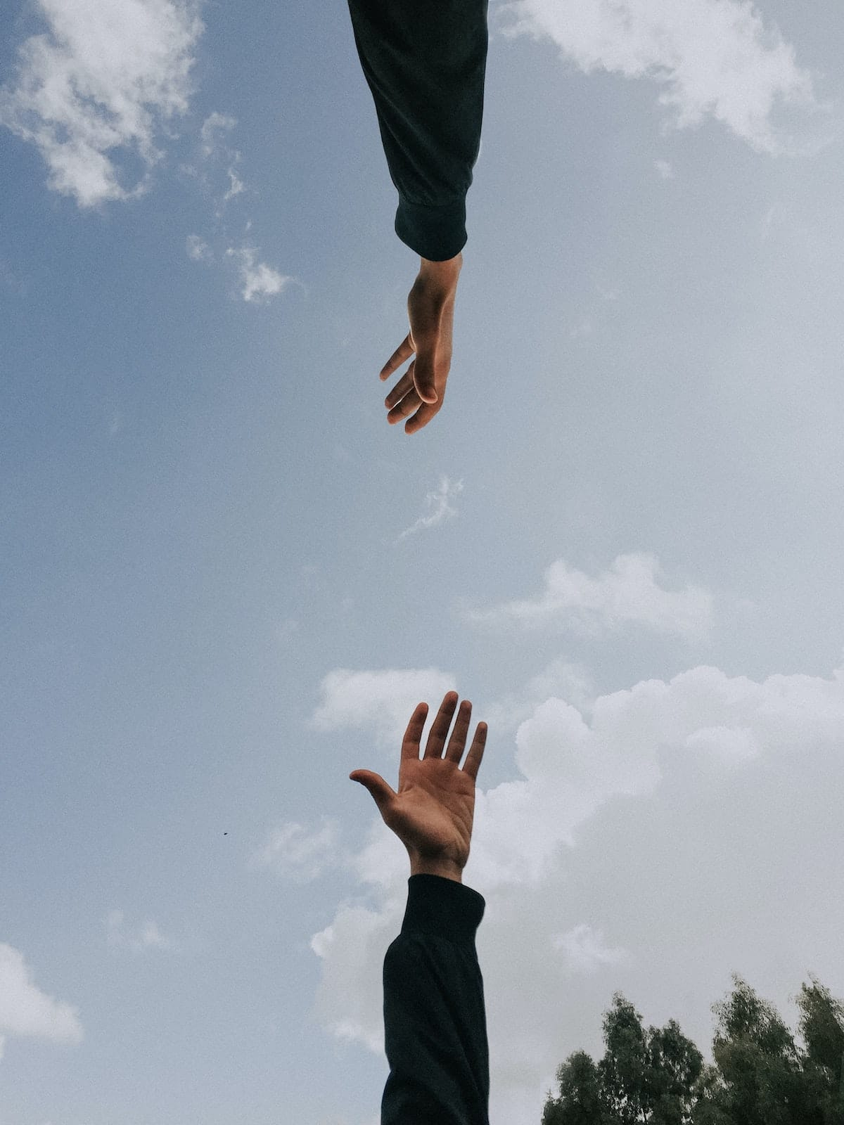 two hands reaching out to meet each other