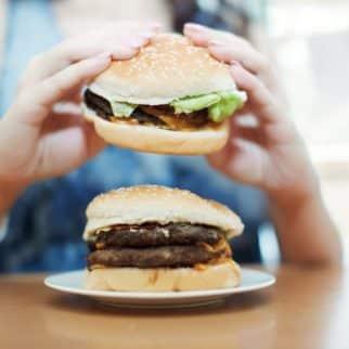 woman eating a cheeseburger