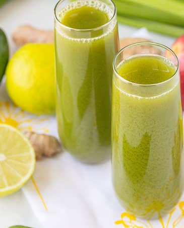 celery cucumber green juice in glasses with ingredients