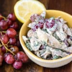 5-ingredient chicken salad with grapes and lemon wedge