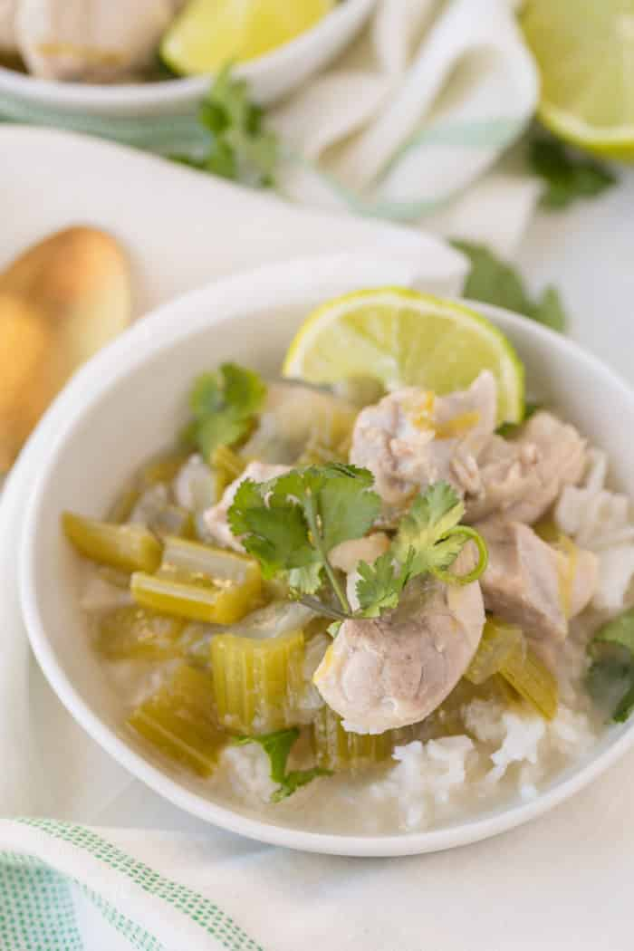 bowl of coconut chicken with lime slices