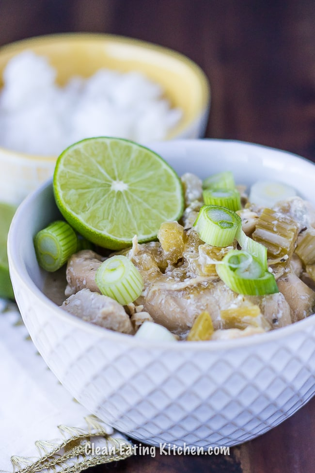 instant pot coconut chicken with rice and lime wedges