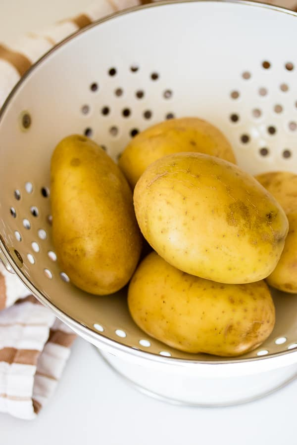 white potatoes in white colander
