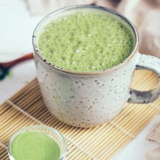 Vegan coconut matcha latte. Powdered green tea latte