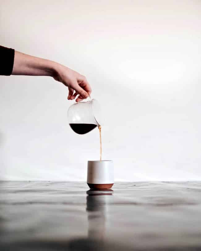 woman pouring coffee