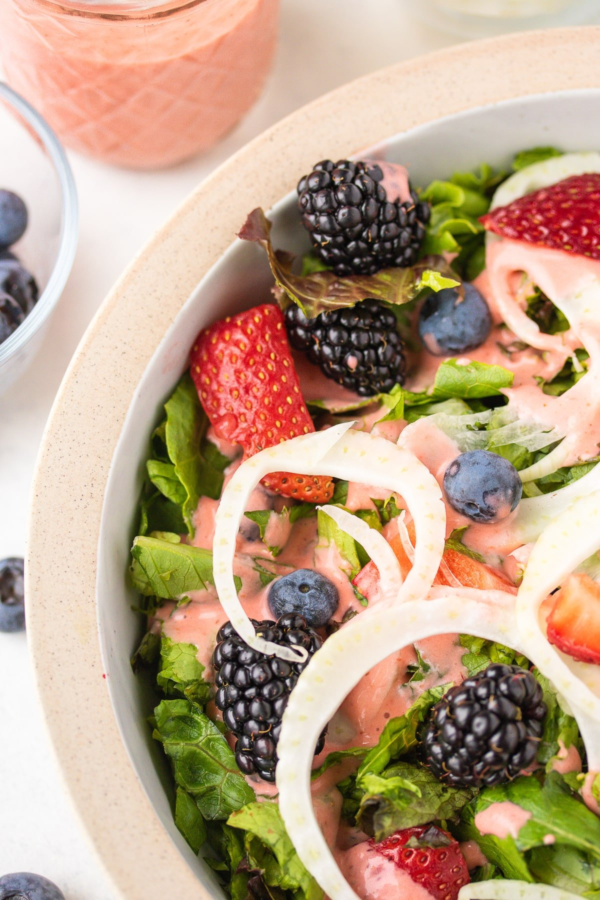 green salad with fennel and berries