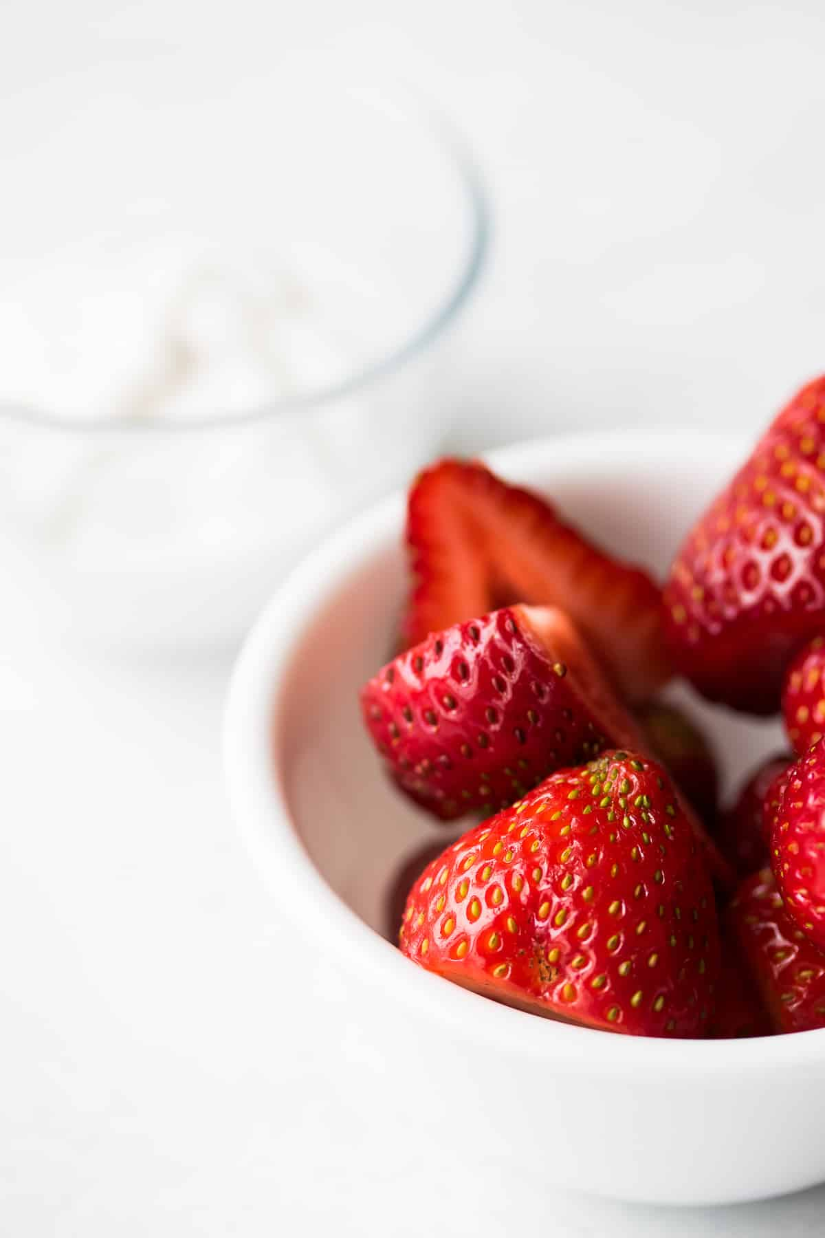 bowl of strawberries with coconut yogurt