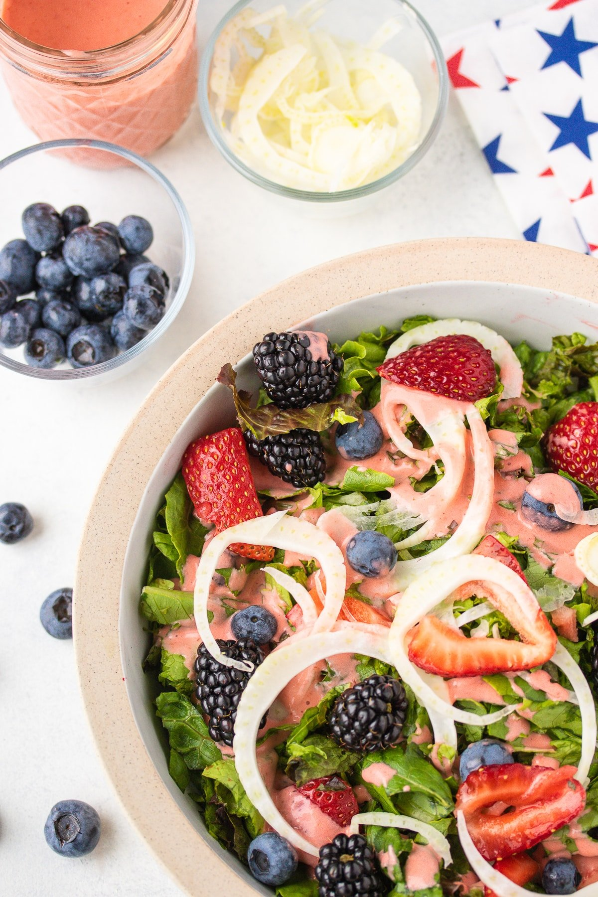 salad with strawberry dressing and patriotic napkin