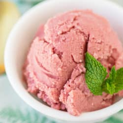 bowl of pink ice cream with fresh mint on top
