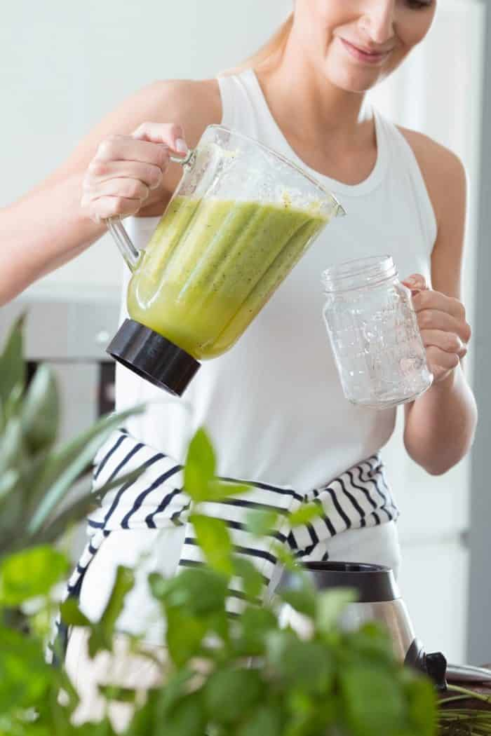 woman pouring a smoothie