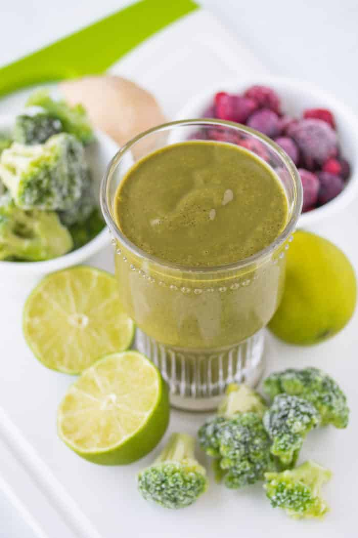 glass of green smoothie with fruit